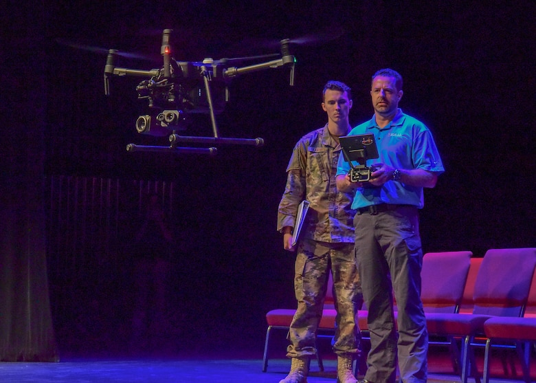 Staff Sgt. Devan Trammel, 628th Civil Engineer Squadron explosive ordnance disposal technician, observes Jeremy Stafford, Ideal Blasting vice president, as he operates a drone during a demonstration at the 2018 Eastern National Robot Rodeo Aug. 13, 2018, at the Charleston convention center in Charleston S.C.