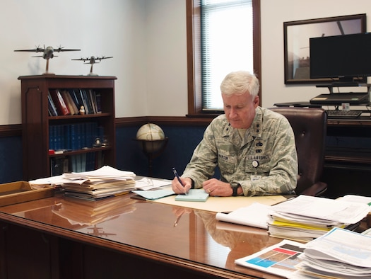 Maj. Gen. Thaddeus Martin works at his desk during his last week as the Connecticut National Guard The Adjutant General (TAG), June 27, 2018 in Hartford, Conn. He led the state for the past 13 years, and relinquished his command July 7, 2018. (U.S. Air National Guard photo by 1st Lt. Jen Pierce)