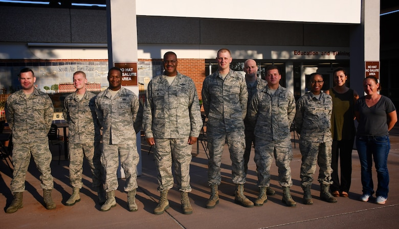 Vice commander of the 932nd Airlift Wing, Col. Esteban Ramirez, at center fourth from left, welcomes new Airmen as he spoke about the reserve wing's mission to newcomers on August 4, 2018, at Scott Air Force Base, Illinois. He talked about his role as a leader and pilot, flying the C-40 aircraft, operated by the 932nd Operations Group. He noted that reservists like him come from 38 states to be part of Unit Training Assembly each month in southern Illinois. The 932nd Airlift Wing is a 22nd Air Force unit under the Air Force Reserve Command.  (U.S. Air Force photo by Lt. Col. Stan Paregien)