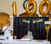 Capt. Maryann Mattonen, commanding officer of Navy Medicine Training Support Center, reads a 100th-birthday letter from Rear Adm. Tina Davidson, director, Navy Nurse Corps, and commander, Navy Medicine Education, Training and Logistics Command, to Blondina Porter, a World War II Navy nurse, at the Brookdale Assisted Living Facility. Porter was honorably discharged from the Navy in 1948, as a lieutenant.