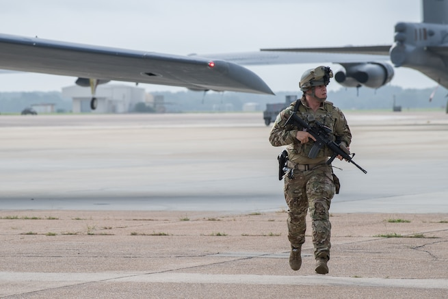 Senior Airman Justin Moshrefi, 2nd Security Forces Squadron installation patrolman, runs across the flight line during a hijacking exercise at Barksdale Air Force Base, La., August 14, 2018.  Like an actual hijacking incident, Airmen weren't given a warning about the simulation.  (U.S. Air Force photo by Airman 1st Class Tessa B. Corrick)