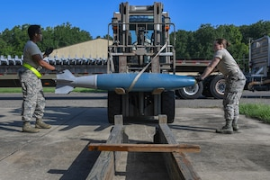 Munitions specialists assigned to the 307th and 910th maintenance squadron train to assemble, handle, transport and store BDU-50 low drag bombs at the 307th MXS munitions storage facility on Barksdale Air Force Base, La., August 16, 2018. (U.S. Air Force photo by Airman 1st Class Maxwell Daigle/Released)