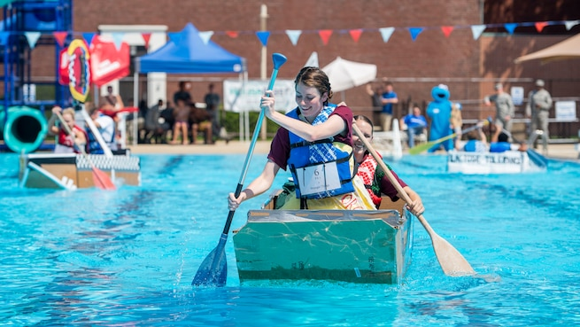 Airman 1st Class Tara Stetler, 375th Air Mobility Wing Public Affairs photojournalist, and Airman 1st Class Kylie Walker, 375th AMW PA broadcast journalist, row their boat to victory