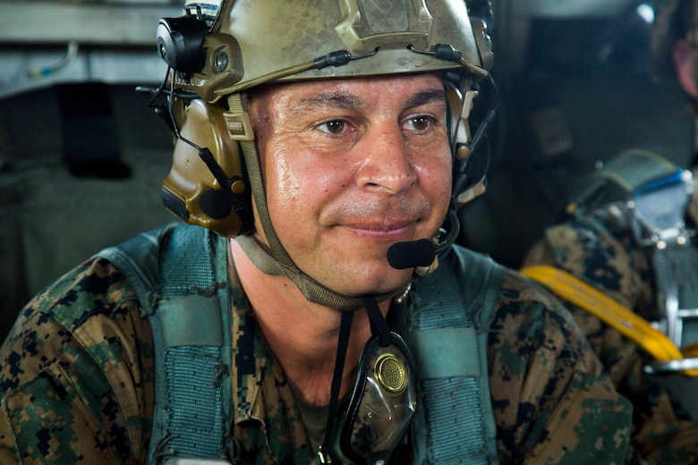 Master Sgt. Gabriel Machado prepares for takeoff during parachute and air delivery training operations Aug. 14, 2018 at Ie Shima, Okinawa, Japan. Machado served as the assistant jumpmaster during the training, keeping in contact with the flight crew inside a CH-53E Super Stallion helicopter while relaying information to the jumpmaster. The training consisted of low-level static line and military free fall jumps at 10,000 feet in order to keep the Marines proficient as parachute rigger/air delivery specialists. Machado, a native of New York, New York, is the air delivery chief with Landing Support Company, 3rd Transportation Support Battalion, 3rd Marine Logistics Group. (U.S. Marine Corps photo by Cpl. Isabella Ortega)