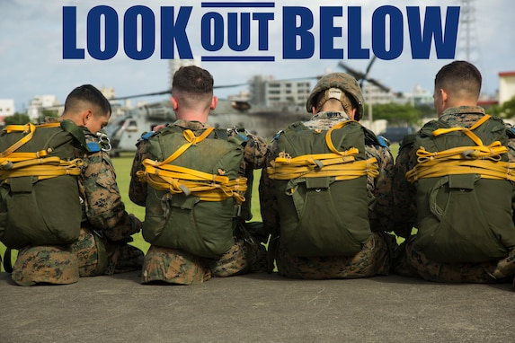 Marines with Landing Support Company, 3rd Transportation Support Battalion, 3rd Marine Logistics Group, wait next to the Camp Foster parade deck to board a CH-53E Super Stallion helicopter during parachute and air delivery training operations Aug. 14, 2018 at Ie Shima, Okinawa, Japan. The training consisted of low-level static line and military free fall jumps at 10,000 feet in order to keep the Marines proficient as parachute rigger/air delivery specialists. (U.S. Marine Corps photo by Cpl. Isabella Ortega)