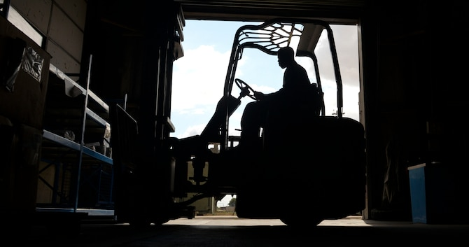 U.S. Air Force Senior Airman Barnell Thomas, 100th Logistics Readiness Squadron aircraft parts store journeyman, unloads a new shipment of supplies in the warehouse at RAF Mildenhall, England, Aug. 8, 2018. The aircraft parts store provides aircraft with mobility readiness spare part kits. The kits are air-transportable packages of spare parts configured for rapid deployment in support of conflict or war. (U.S. Air Force photo by Airman 1st Class Alexandria Lee)