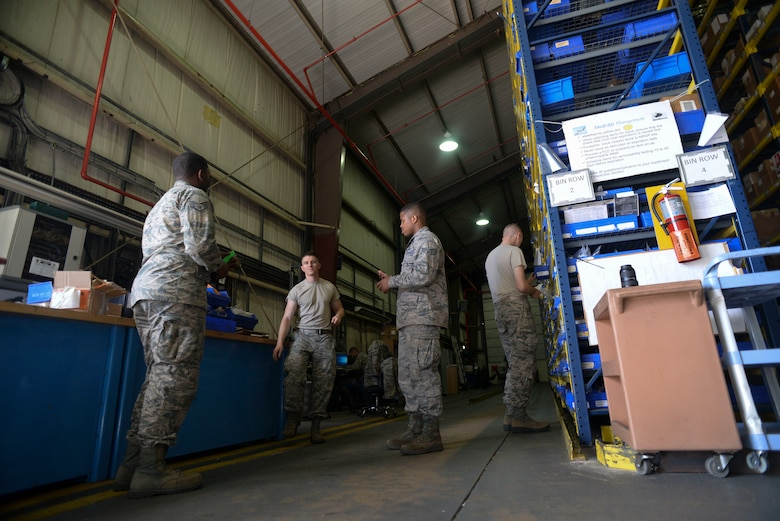U.S. Air Force Airmen from the 100th Logistics Readiness Squadron have an end of day briefing in the aircraft parts store warehouse at RAF Mildenhall, England, Aug. 8, 2018. The aircraft parts store's main purpose is to provide flightline support to the aircraft maintenance crews 24-hours a day, seven-days-a-week. (U.S. Air Force photo by Airman 1st Class Alexandria Lee)