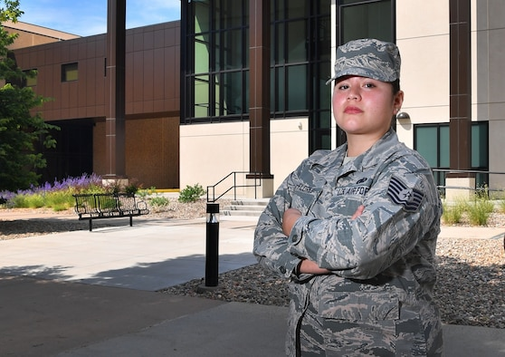 U.S. Air Force Tech. Sgt. Carmen Mena-Flores, Commander's Support Staff noncommissioned officer in charge, was just presented the Chief's Choice Award at Schriever Air Force Base, Colorado, July 2018. Mena-Flores was diagnosed with stage-three breast cancer in 2015 and has since dedicated herself to serving fellow recovering Airmen through efforts with the Air Force Wounded Warrior (AFW2) Program; she is now in remission. (U.S. Air Force courtesy photo)