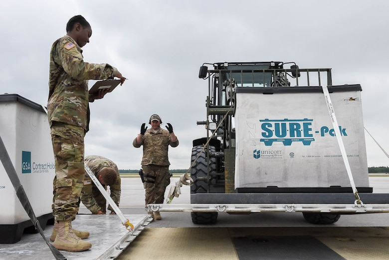 Tech. Sgt. Jason Kennedy, an aerial port specialist assigned to the Kentucky Air National Guard's 123rd Contingency Response Group, directs a cargo palette to a cargo distribution area while supporting Operation Huron Thunder at the Alpena Combat Readiness Training Center in Alpena, Mich., July 22, 2018. The 123rd CRG worked in conjunction with the U.S. Army's 690th Rapid Port Opening Element to operate a Joint Task Force-Port Opening during the exercise. The objective of the JTF-PO is to establish a complete air logistics hub and surface distribution network. (U.S. Air National Guard photo by Maj. Allison Stephens)