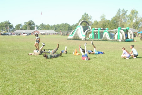 On August 10, 2018 MCES hosted its annual Kids Rock Day at Courthouse Bay.  The morning was filled with various activities to include:  a fartlek run with obstacles, dry bounce-house, bounce-house with water slide, Indoor Simulated Marksmanship Trainer (ISMT), static display of equipment, and water soccer.  In the afternoon Marines had the opportunity to take their children to their work areas.  Kids Rock Day allows children of the Marines, Sailors, and civilians within MCES to experience, in a safe and controlled environment; engineer, utilities, and Marine-themed activities with their parents.