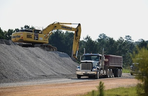A construction crew contracted by the 14th Flying Training Wing prepares to transport stones to the outside runway July 26, 2018, on Columbus Air Force Base, Mississippi. The last time this large of a runway project was completed was in 2005. (U.S. Air Force photo by Airman 1st Class Keith Holcomb)