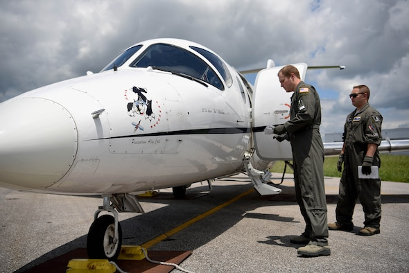 Second Lt. Kevin Pollard, 48th Flying Training Squadron student pilot, and 1st Lt. Chris Breyfogle, 48th FTS instructor pilot, inspect a T-1 Jayhawk before a training sortie July 23, 2018, from the Golden Triangle Regional Airport in Columbus, Mississippi. Each flying training squadron has had to work with the 14th Operations Group to schedule and plan around the resurfacing, but the 48th FTS was greatly affected and has been the squadron to take the mantel of flying almost half of their sorties out and back from a completely different location. (U.S. Air Force photo by Airman 1st Class Keith Holcomb)