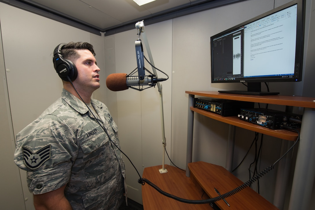 Staff Sgt. Jared Lindley, 2nd Weather Squadron NCO in charge of American Forces Network Weather Center (AFNWC), records a voiceover for a Southwest Asia forecast Aug. 9, 2018, at Offutt Air Force Base, Nebraska. The AFNWC's forecasts reach almost a million service members, government employees and their families through American Forces Network and Stars and Stripes. (U.S. Air Force photo by Paul Shirk)