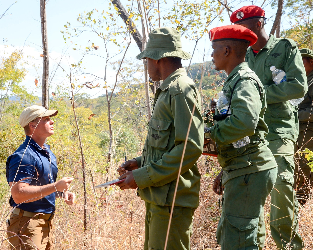 Army Maj. Kevin Jusza, with the 404th Civil Affairs Battalion, assigned to Combined Joint Task Force Horn of Africa, provides guidance for Tanzania Wildlife Management Authority game wardens during a ground surveillance practical exercise in Ngwala, Tanzania, July 24, 2018. Navy photo by Petty Officer 2nd Class Timothy M. Ahearn