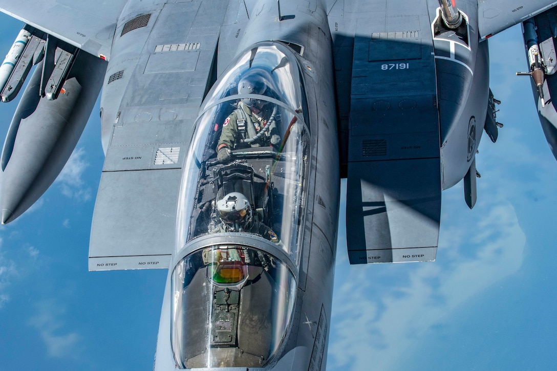 A KC-135 Stratotanker with the 121st Air Refueling Wing, Ohio refuels an F-15E Strike Eagle with the 4th Fighter Wing at Seymour Johnson Air Force Base, North Carolina over the southeastern United States August 8, 2018. The aerial refueling was an exercise to keep pilots and crew proficient and mission ready.  (U.S. Air National Guard photo by Airman 1st Class Tiffany A. Emery)