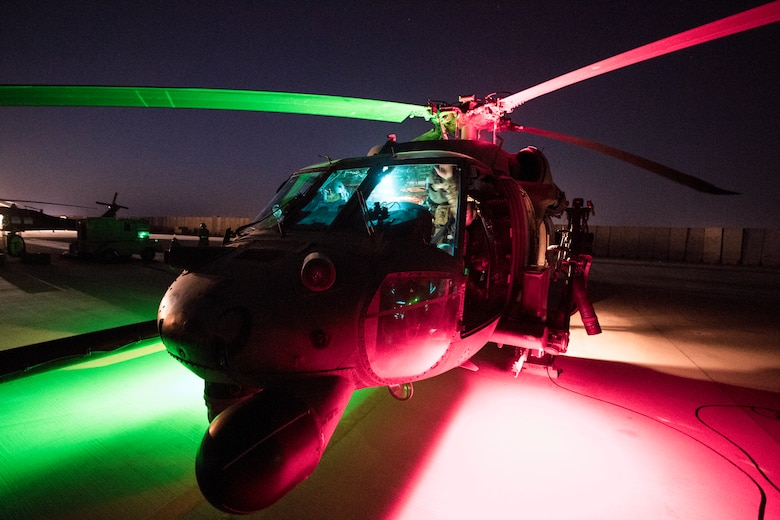 A U.S. Air Force HH-60G Pavehawk assigned to the 46th Expeditionary Rescue Squadron sits on the flight line as aircrew members pre flight the aircraft before a mission at an undisclosed location, Iraq, in support of Operation Inherent Resolve Aug. 8, 2018. The 46th ERQS provides combat search and rescue capabilities across the region in support of Operation Inherent Resolve. In conjunction with partner forces, Combined Joint Task Force - Operation Inherent Resolve defeats ISIS in designated areas of Iraq and Syria and sets conditions for follow-on operations to increase regional stability. (U.S. Air Force photo by Staff Sgt. Keith James)
