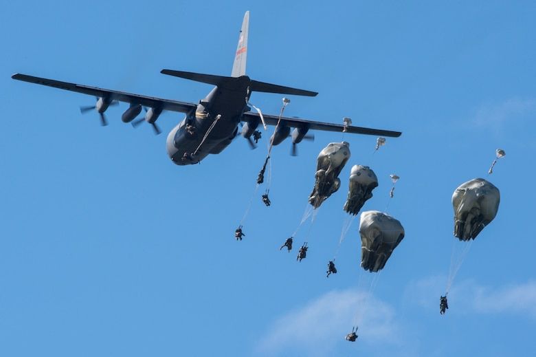 U.S. Army paratroopers assigned to the 4th Infantry Brigade Combat Team, 25th Infantry Division, U.S. Army Alaska, jump from an Illinois Air National Guard C-130 Hercules while conducting airborne training at Malemute Drop Zone, Joint Base Elmendorf-Richardson, Alaska, Aug. 9, 2018. The Soldiers of 4/25 belong to the only American airborne brigade in the Pacific and are trained to execute airborne maneuvers in extreme cold weather and high altitude environments in support of combat, partnership and disaster relief operations. Airmen from the 169th Airlift Squadron out of Peoria Air National Guard Base, Peoria, Ill., operated the C-130 Hercules. (U.S. Air Force photo by Alejandro Peña)