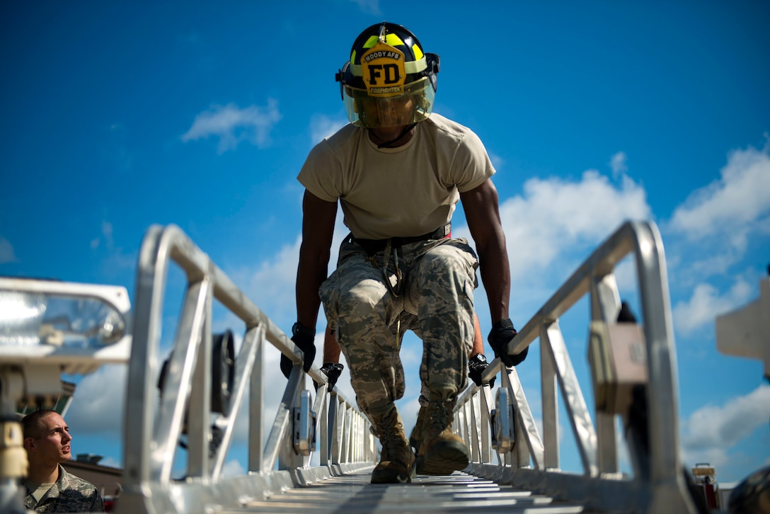 "Airman 1st Class Jared King, 23d Civil Engineer Squadron water and fuel system maintenance apprentice, interns as a firefighter during the ""A Day In A Life"" program, Aug. 10, 2018 at Moody Air Force Base, Ga. The program challenges participating civil engineers to go behind-the-scenes to perform multiple jobs to better understand their fellow Airmen and better develop operational leaders. The firefighters from the 23d CES train daily through their multifaceted capabilities in fire prevention to ensure they are proficient in their duties to keep Moody safe. (U.S. Air Force photo by Airman 1st Class Erick Requadt)"