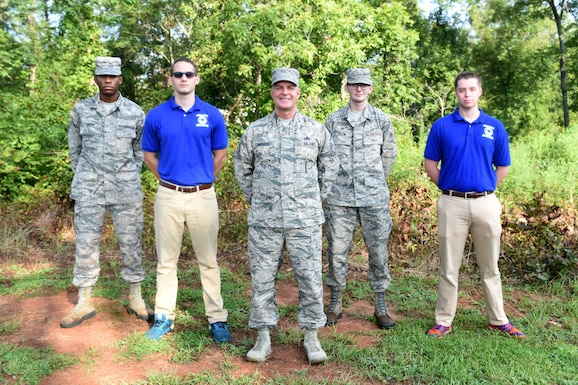 Master Sgt. Kenny Monroe, 169th Fighter Wing Recruiting and Retention Office Manager poses with Airmen from the 169th Student Flight