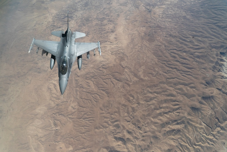 A U.S. Air Force F-16 Fighting Falcon descends away from a KC-135 Stratotanker after receiving fuel to continue its mission in support of Operation Inherent Resolve over Iraq, Aug. 11, 2018. In conjunction with partner forces, Combined Joint Task Force - Operation Inherent Resolve defeats ISIS in designated areas of Iraq and Syria and sets conditions for follow-on operations to increase regional stability. (U.S. Air Force photo by Master Sgt. Burt Traynor)
