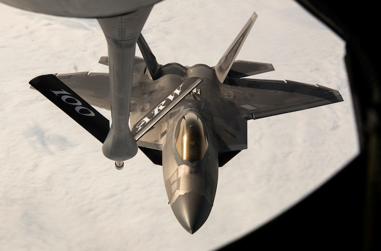 A U.S. Air Force F-22 Raptor from the 95th Fighter Squadron, Tyndall Air Force Base, Fla., receives fuel from a U.S Air Force Boeing KC-135 Stratotanker assigned to the 100th Air Refueling Wing, Royal Air Force Mildenhall, England, above Norway, Aug. 15, 2018. The F-22s practiced refueling and trained with Royal Norwegian air force F-35A Lightning II aircraft during a forward deployment to Orland Air Base, Norway. (U.S. Air Force photo by Senior Airman Preston Cherry)