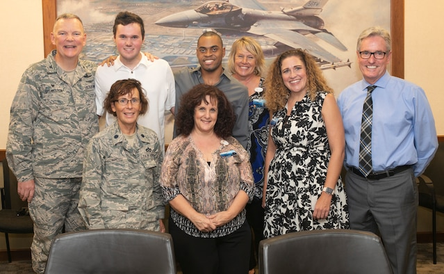 Leadership from Luke Air Force Base poses for a group photo with staff from the West Maricopa Education Center Aug. 14, 2018, at Luke Air Force Base, Ariz.