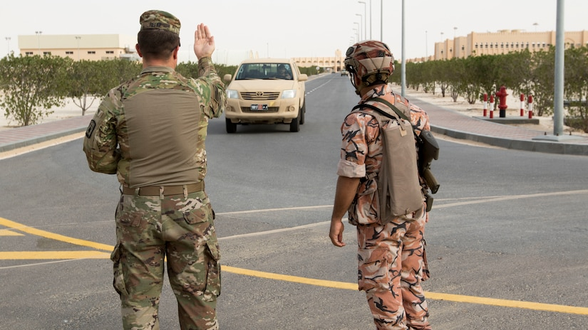 U.S. Army Staff Sgt. Christopher Reitz, a team lead assigned to the 157th Military Engagement Team, Wisconsin Army National Guard, attached to U.S. Army Central, instructs a driver to approach a vehicle control point at a practical exercise held in Haima, Oman, Aug. 8, 2018. During the practical exercise Soldiers from the 157th MET and the Royal Army of Oman's Border Guard Brigade shared their preferred techniques and methods to conduct border security to strengthen both country's defensive capabilities.