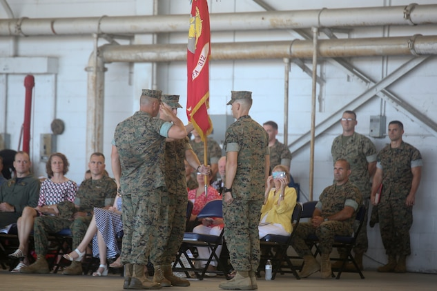 Lt. Col. Benedict G. Buerke relinquishes command of Marine Fighter Attack Squadron 312 to Lt. Col. Steven B. Bowden aboard Marine Corps Air Station Beaufort Aug. 10. During the ceremony, Buerke was awarded the Bronze Star for his service as the commanding officer of the Checkerboards.