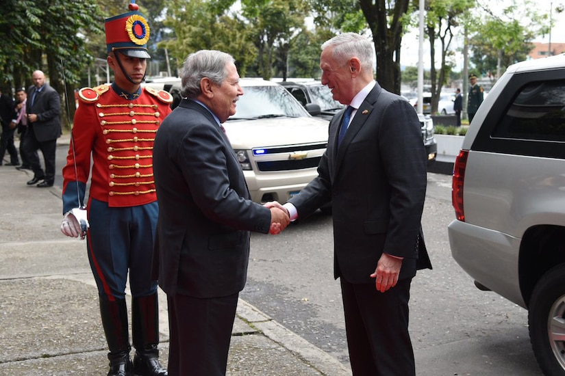 Defense Secretary James N. Mattis shakes hands with Colombian Defense Minister Guillermo Botero.