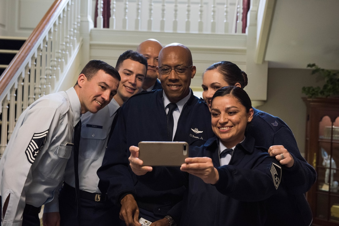 Gen. CQ Brown, Jr., Pacific Air Forces commander, takes a photo with 337th Air Support Flight Airmen at the U.S. Embassy in Canberra, Australia, Aug. 10, 2018. His first trip to the region since taking command on July 26, 2018, Brown also met with key defense and military leaders in Canberra and Royal Australian Air Force Bases Williamtown, Tindal and Darwin to see first-hand the strength of the U.S.-Australia alliance and discuss opportunities to ensure a free and open Indo-Pacific region. (U.S. Air Force photo by Staff Sgt. Hailey Haux)