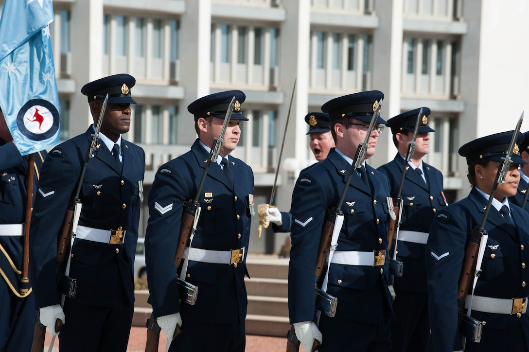 Members from Australia's Federation Guard and the band prepare for the Honor Guard Ceremony to welcome Gen. CQ Brown, Jr., Pacific Air Forces commander, upon his arrival to the Russell Offices, Canberra, Australia, Aug. 10, 2018. His first trip to the region since taking command on July 26, 2018, Brown met with key defense and military leaders in Canberra and Royal Australian Air Force Bases Williamtown, Tindal and Darwin to see first-hand the strength of the U.S.-Australia alliance and discuss opportunities to ensure a free and open Indo-Pacific region. (U.S. Air Force photo by Staff Sgt. Hailey Haux)