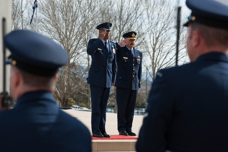 Gen. CQ Brown, Jr., Pacific Air Forces commander, and Air Marshal Leo Davies, Royal Australian Air Force (RAAF) chief of Air Force, salute Australia's Federation Guard and band members during a ceremony at the Russell Offices, Canberra, Australia, Aug. 10, 2018. His first trip to the region since taking command on July 26, 2018, Brown met with key defense and military leaders in Canberra and RAAF Bases Williamtown, Tindal and Darwin to see first-hand the strength of the U.S.-Australia alliance and discuss opportunities to ensure a free and open Indo-Pacific region. (U.S. Air Force photo by Staff Sgt. Hailey Haux)