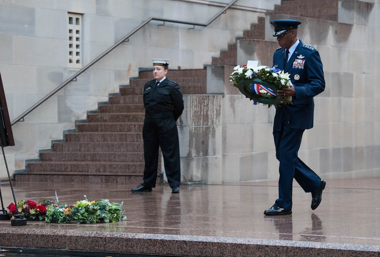 "Gen. CQ Brown, Jr., Pacific Air Forces commander, lays a wreath at the foot of a portrait of Pvt. Robert Young of the Australian Army during a ""Last Post"" ceremony at the Australia War Memorial in Canberra, Australia, Aug. 11, 2018. Young fought in World War II and died March 21, 1944. (U.S. Air Force photo by Staff Sgt. Hailey Haux)"