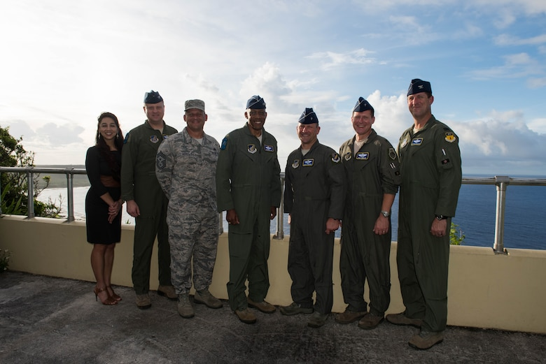 Gen. CQ Brown, Jr. (center), Pacific Air Forces commander, takes a photo with Brig. Gen. Gentry Boswell, 36th Wing commander, and members of his team during a brief tour of Anderson Air Force Base, Guam, Aug. 14, 2018. During the tour, Boswell highlighted the ongoing construction projects occurring throughout the base to enhance its role as a power projection platform. (U.S. Air Force photo by Staff Sgt. Hailey Haux)