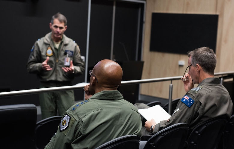 Gen. CQ Brown, Jr., Pacific Air Forces commander, attends a briefing by Air Commodore Rob Chipman, General Capability Planning director, at Royal Australian Air Force (RAAF) Base Williamtown, Australia, Aug. 9, 2018. His first trip to the region since taking command on July 26, 2018, Brown also met with key defense and military leaders in Canberra and RAAF Bases Tindal and Darwin to see first-hand the strength of the U.S.-Australia alliance and discuss opportunities to ensure a free and open Indo-Pacific region. (U.S. Air Force photo by Staff Sgt. Hailey Haux)