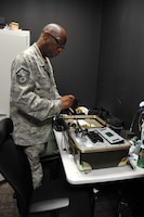 Master Sgt. Ray Reynolds, 403rd Operations Support Squadron aircrew flight equipment supervisor, plugs in a pair of night vison goggles for testing, which is given either a go for use or no go and needs repair. The equipment has to be inspected before and after every flight and a routine inspection is completed every 120 days. (U.S. Air Force photo by Master Sgt. Jessica Kendziorek)