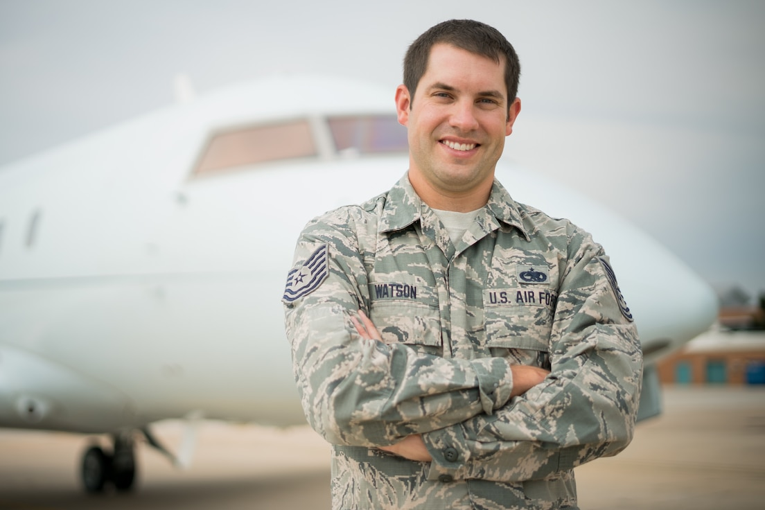 Tech. Sgt. Brian Watson, 1st Aviation Standards Flight aircraft mechanic, poses for a photo near a Bombardier Challenger 601 July 23, 2018, at Will Rogers World Airport, Okla.