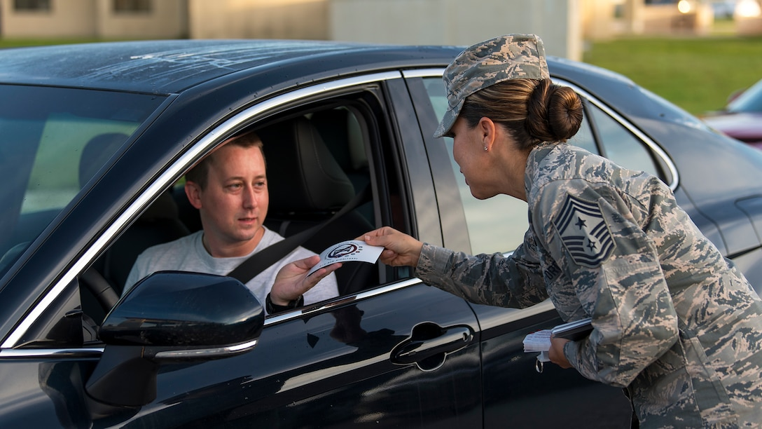 Chief Master Sgt. Sarah Sparks, 6th Air Mobility Wing command chief, hands out a Joint Services Against Drunk Driving (JSADD) card at MacDill Air Force Base, Fla., Aug. 17, 2018. JSADD offers a free, anonymous and safe alternate mode of transportation for those who have been drinking and are unable to secure a ride home with a single phone call to 813 – 828 – RIDE (4473).