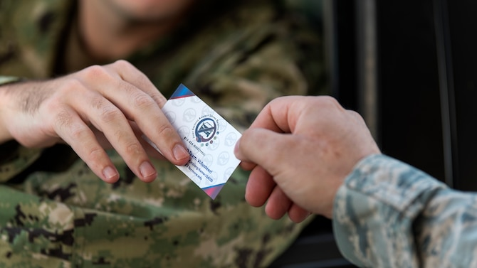 A U.S. Navy sailor takes a Joint Services Against Drunk Driving card at MacDill Air Force Base, Fla., Aug. 17, 2018. JSADD offers a free, anonymous and safe alternate mode of transportation for those who have been drinking and are unable to secure a ride home with a single phone call to 813 – 828 – RIDE (4473)