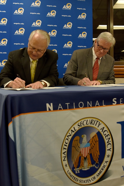 Angelo State University president, Dr. Brian May, and National Cryptologic School commandant, Dr. Leonard Reinsfelder, sign the ASU and NCS Articulation Agreement during a signing ceremony at ASU's Houston Harte University Center in San Angelo, Texas, Aug. 16, 2018. During the ceremony, both men mentioned the importance of having better educated and qualified individuals working in the intelligence field. (U.S. Air Force photo by Staff Sgt. Joshua Edwards/Released)