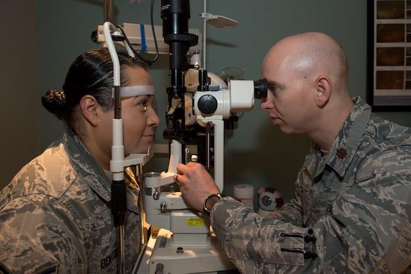 Photo of an eye exam administered by Maj. Kyle Hiatt