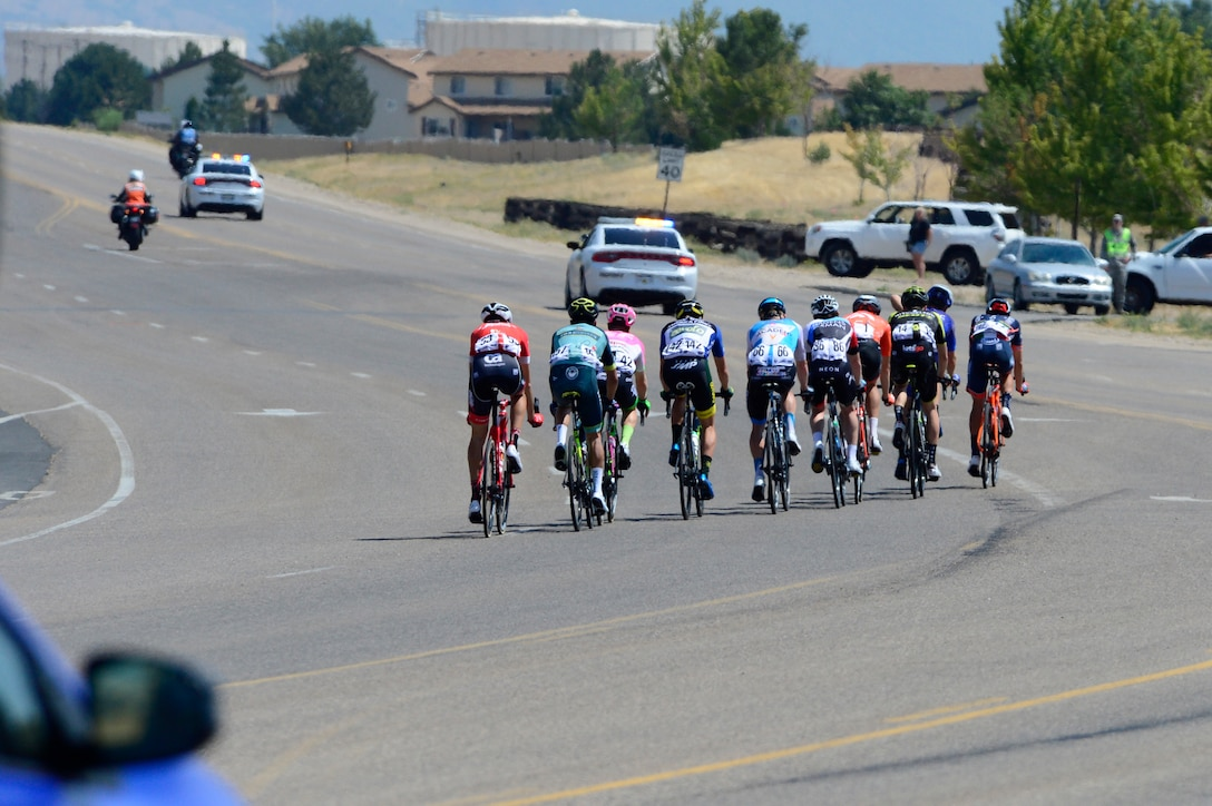 A breakaway of 10 riders during stage 3 of the 2018 Tour of Utah road race Aug. 9, 2018, at Hill Air Force Base, Utah. The Tour of Utah is one of the top professional cycling events in the country and showcases some of the world's best teams and cyclists. Stage 3 of the multiday race took riders on a 116-mile route from Antelope Island to Layton and included a loop through the installation. (U.S. Air Force photo by David Perry)