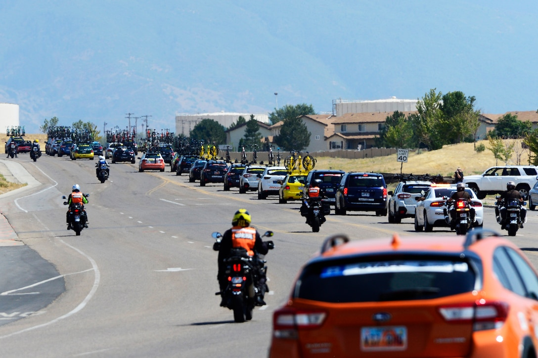 Support vehicles follow riders during stage 3 of the 2018 Tour of Utah road race Aug. 9, 2018, at Hill Air Force Base, Utah. The Tour of Utah is one of the top professional cycling events in the country and showcases some of the world's best teams and cyclists. Stage 3 of the multiday race took riders on a 116-mile route from Antelope Island to Layton and included a loop through the installation. (U.S. Air Force photo by David Perry)