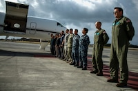 Defense POW/MIA Accounting Agency (DPAA) personnel await the movement of transfer cases during an honorable carry ceremony at Marine Corps Air Station Kaneohe Bay, Marine Corps Base Hawaii, Aug. 1, 2018. The remains, recently repatriated from Kiribati, are believed to be linked to unidentified service members that went missing in action during the Battle of Tarawa in WWII. DPAA conducts global search, recovery and laboratory operations to provide the fullest possible accounting for our missing personnel to their families and the nation. (U.S. Marine Corps photo by Sgt. Aaron S. Patterson)
