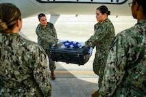 An honor guard detail tasked by the Defense POW/MIA Accounting Agency (DPAA) moves transfer cases for transport during an honorable carry ceremony at Marine Corps Air Station Kaneohe Bay, Marine Corps Base Hawaii, Aug. 1, 2018. The remains, recently repatriated from Kiribati, are believed to be linked to unidentified service members that went missing in action during the Battle of Tarawa in WWII. DPAA conducts global search, recovery and laboratory operations to provide the fullest possible accounting for our missing personnel to their families and the nation. (U.S. Marine Corps photo by Sgt. Aaron S. Patterson)
