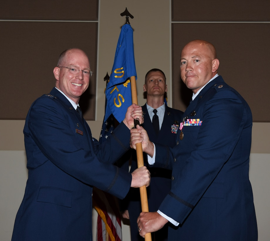 Col. Troy Endicott, 460th Space Wing commander, receives the guidon from Lt Col. Christopher Humphrey, 460th Comptroller Squadron outgoing commander, July 19, 2018, on Buckley Air Force Base, Colorado. The exchanging of the guidon symbolizes the official change of command. (U.S. Air Force photo by Airman 1st Class Michael D. Mathews)