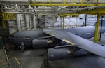 A C-17 Globemaster III from Travis Air Force Base, Calif., sits in a paint barn hangar for paint touch-ups Aug. 6, 2018, at Joint Base Lewis-McChord, Wash. California laws prevent Travis Airmen from spray-painting their C-17s, so they brought it to McChord where it is allowed. (U.S. Air Force photo by Senior Airman Tryphena Mayhugh)