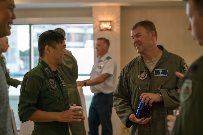 Koku Jieitai (Japan Air Self-Defense Force) Lt. Col. Ryouhei Nakashima (left) and U.S. Air Force Lt. Col. Daniel Roberts, Chief Aviation Management Branch, PACAF Human Factors (right) socialize during the Asia-Pacific Aviation Safety Subject Matter Expert Exchange (APASS) in Honolulu, Hawaii, Aug. 14, 2018. APASS allows partner nations in the Indo-Pacific to discuss aviation safety practices and devise  solutions to challenges faced by the various air forces. (U.S. Air Force photo by Staff Sgt. Daniel Robles)