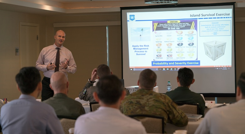 Darron Haughn, Chief of Aviation Safety, Air Force Space Command, gives a presentation about resource and risk management at the Asia-Pacific Aviation Safety Subject Matter Expert Exchange (APASS) in Honolulu, Hawaii, Aug. 14, 2018. APASS allows partner nations in the Indo-Pacific to discuss aviation safety practices and devise solutions to challenges faced by the various air forces. (U.S. Air Force photo by Staff Sgt. Daniel Robles)