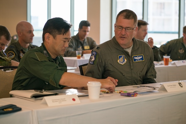 Koku-Jieitai (Japan Air Self-Defense Force) Lt. Col. Ryouhei Nakashima (left) and U.S. Air Force Col. Tim Cullen, Pacific Air Forces director of safety, work together during a group activity as part of the Asia-Pacific Aviation Safety Subject Matter Expert Exchange (APASS) in Honolulu, Hawaii, Aug. 14, 2018. APASS allows partner nations in the Indo-Pacific to discuss aviation safety practices and devise solutions to challenges faced by the various air forces. (U.S. Air Force photo by Staff Sgt. Daniel Robles)
